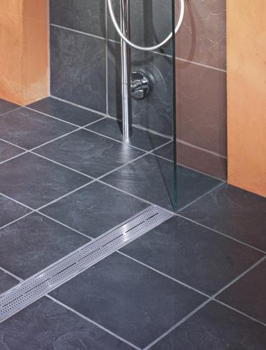 Las duchas de obra aumentan el espacio en el ba o aqua for Ducha sin plato suelo